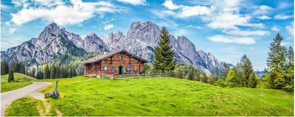 JFL-Photography-87915458-Idyllic-landscape-in-the-Alps-with-mountain-chalet-and-green-meadows
